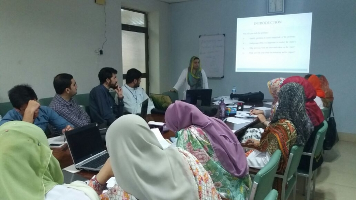 Guest Speaker Assoc. Prof. Dr. Saira Afridi (Sardar Begum Dental College) Delivering Lecture at the Research Workshop