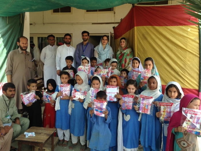 Ms. Shahana Zubair (BoG Member), Dr. Mohammad Imad Khan (Community Dentistry) distributed free toothbrush and toothpaste in school kids sponsered by Colgate